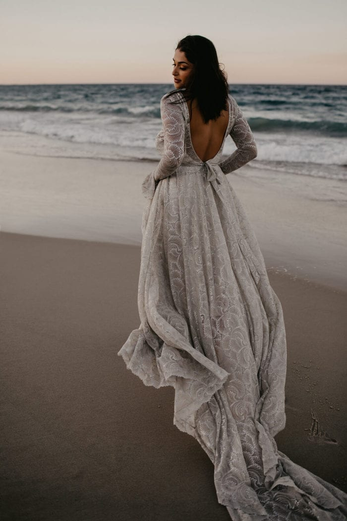 Back shot of bride wearing Grace Loves Lace Bea Gown on beach