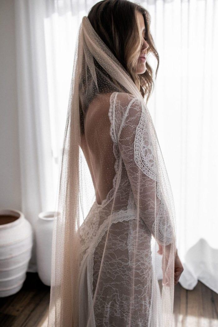 Back shot of bride wearing Nude Gold Grace Loves Lace Shimmy Veil