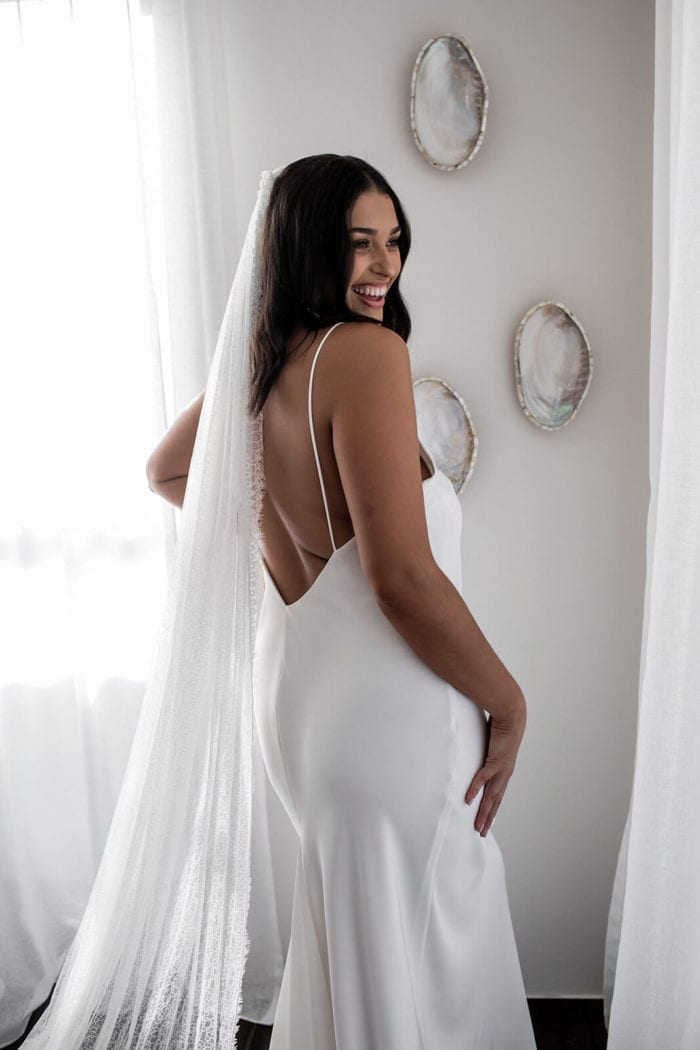 Bride wears Grace Loves Lace Chantilly Veil while laughing