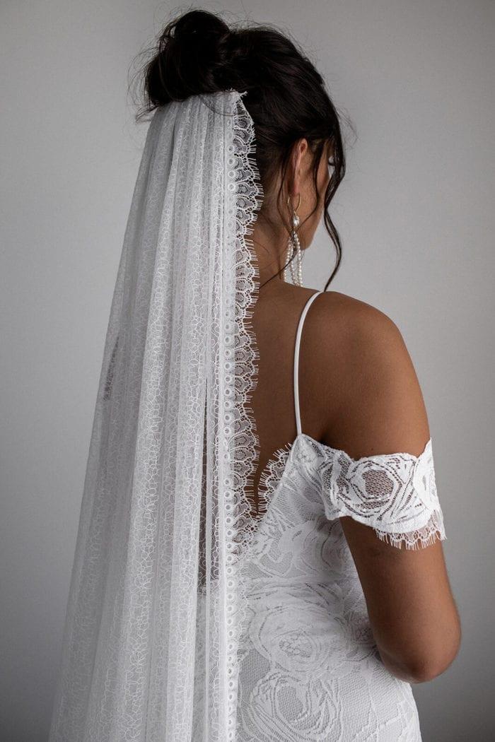 Back shot of bride wearing Grace Loves Lace Chantilly Veil, secured to underside of bun