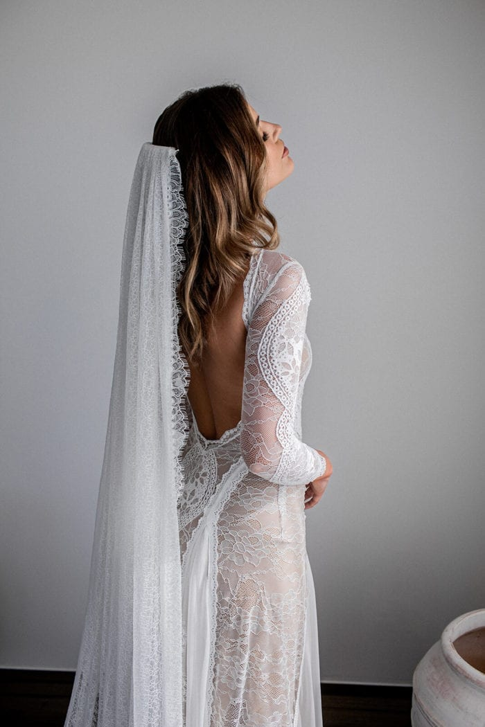Bride wearing Grace Loves Lace Chantilly Veil, facing upward with eyes closed