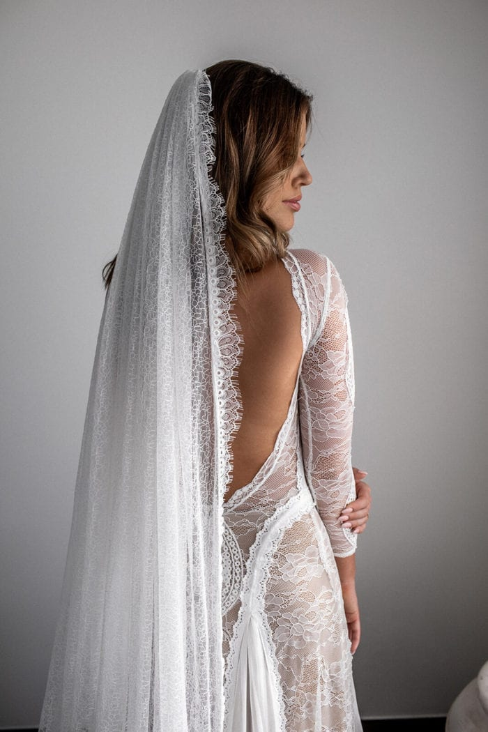 Back shot of bride wearing Grace Loves Lace Chantilly Veil with face covered by her hair