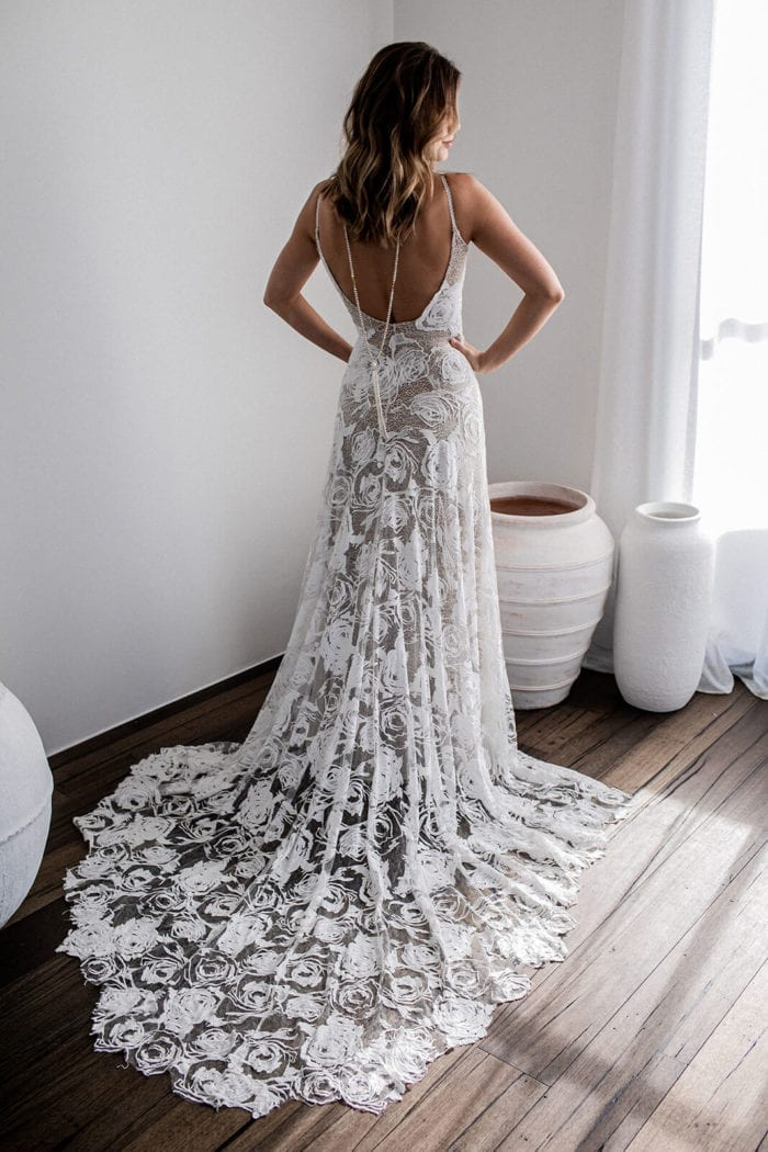 Back shot of bride wearing Grace Loves Lace Mata Backpiece with hands on hips