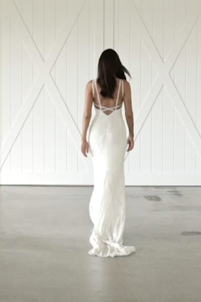 Back shot of bride wearing Grace Loves Lace Leon Gown