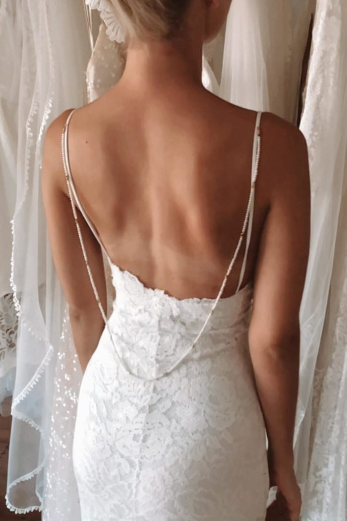 Back shot of bride wearing Grace Loves Lace Hart Gown wearing backpiece