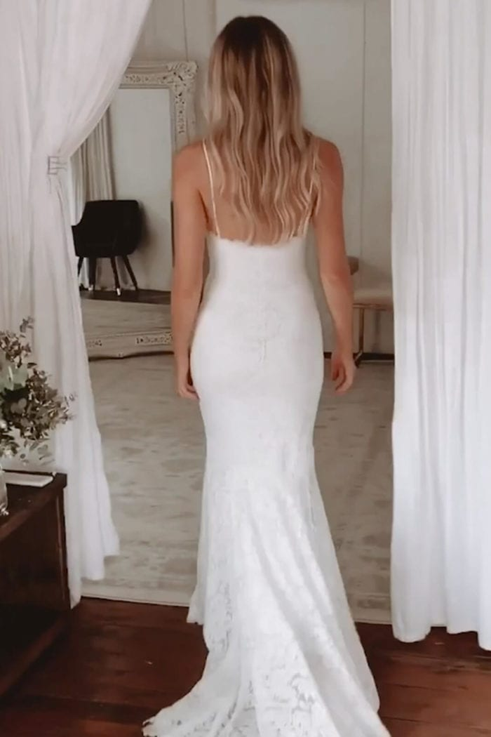 Back shot of bride wearing Grace Loves Lace Hart Gown