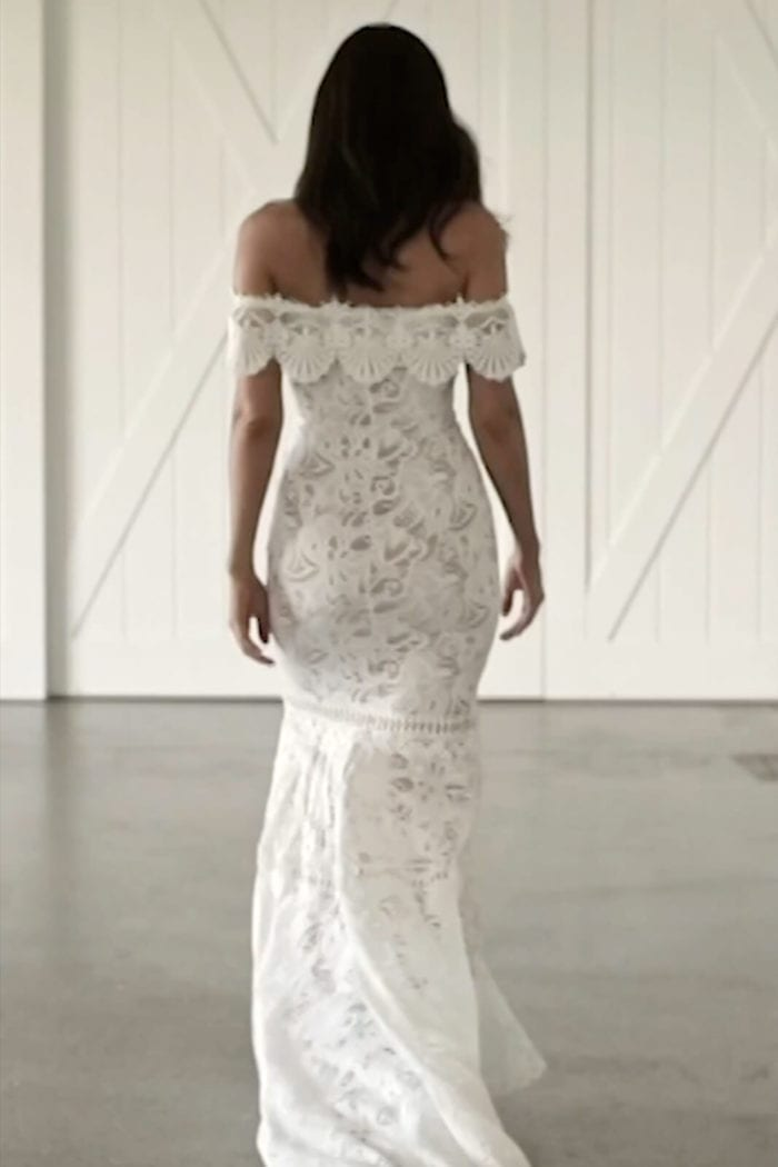 Back shot of bride wearing Grace Loves Lace Cien Gown