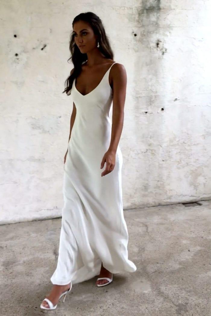 Brunette bride wearing Grace Loves Lace Arlo Gown walking