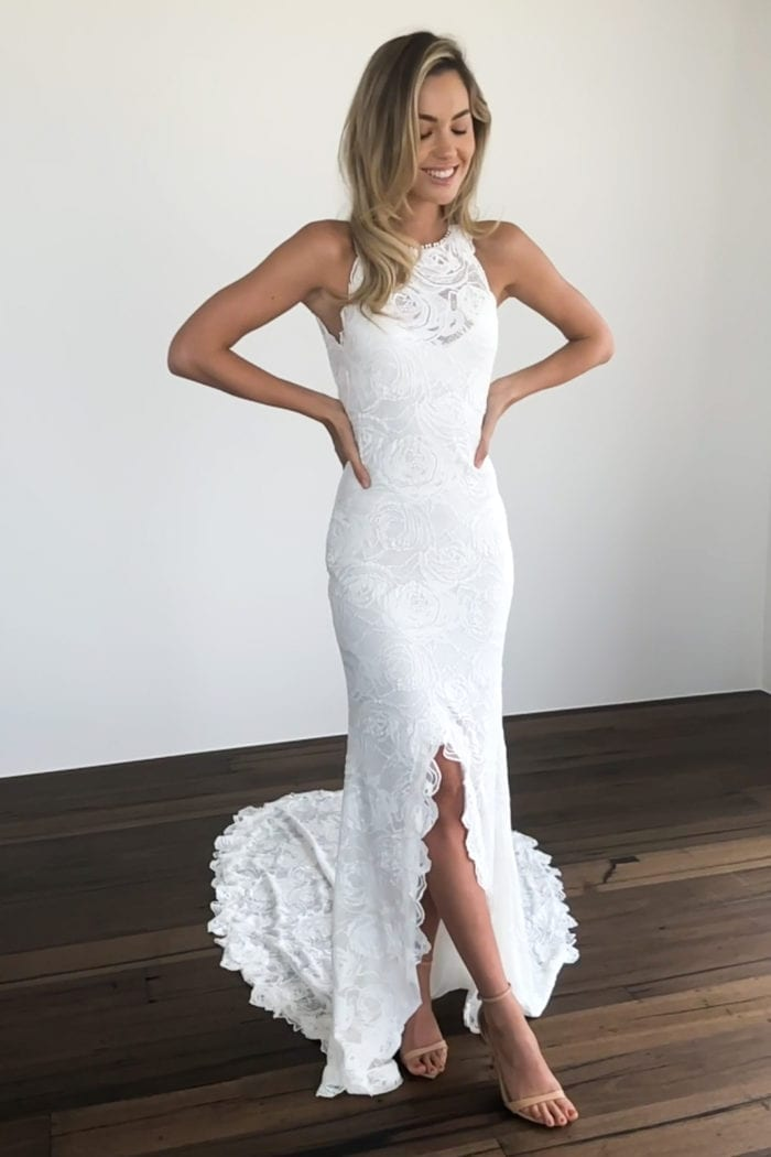 Bride wearing Grace Loves Lace Alexandra Rose Gown with hands on hips