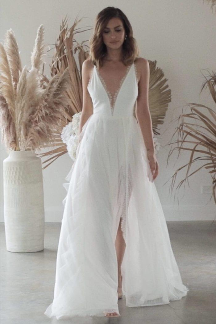 Bride wearing Grace Loves Lace Song Gown walking
