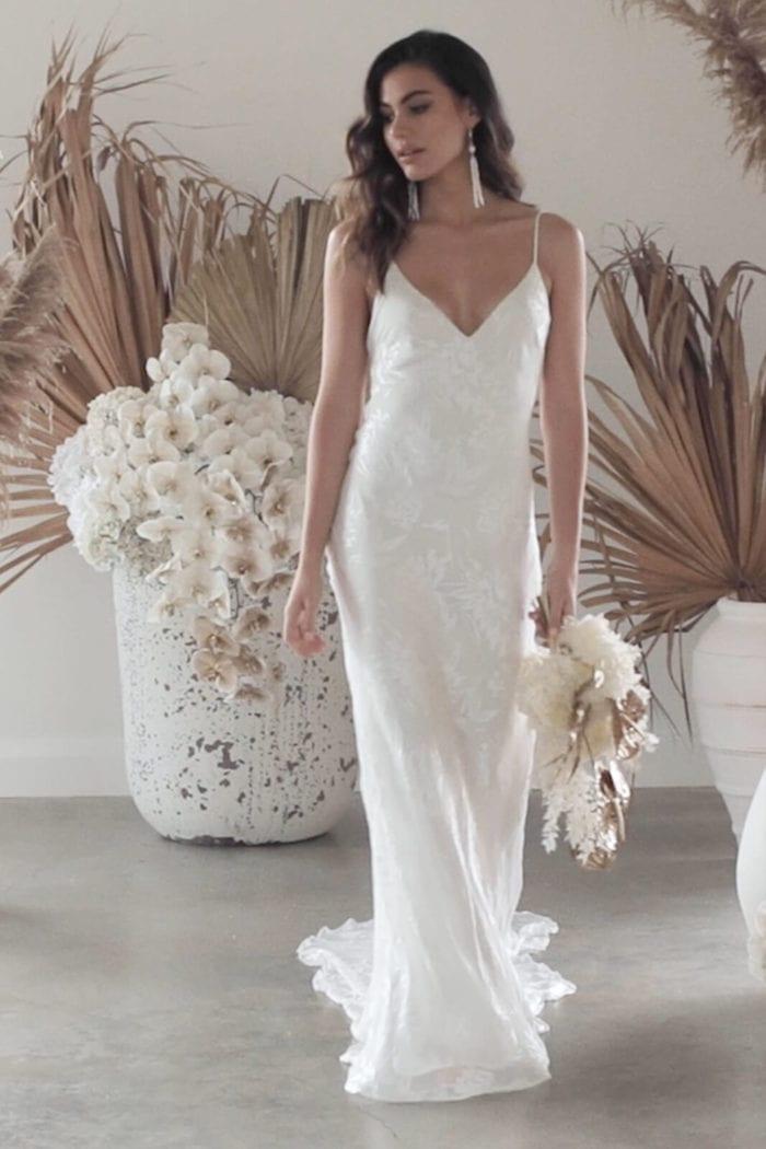 Brunette bride wearing Grace Loves Lace Loyola Gown holding bouquet