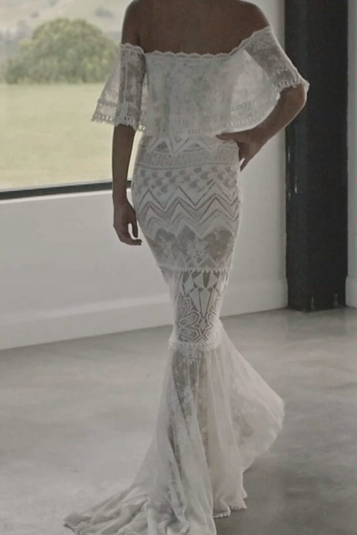 Back shot of bride wearing Grace Loves Lace Emanuela Gown with hand on hip