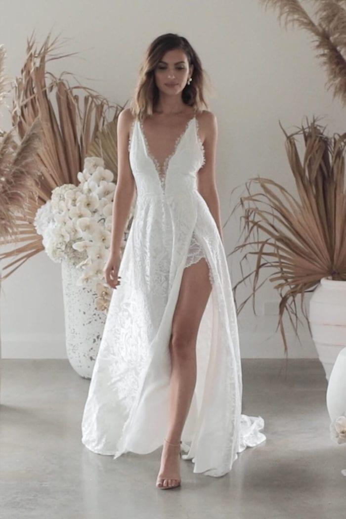 Brunette bride wearing Grace Loves Lace Darling Gown with leg showing in split