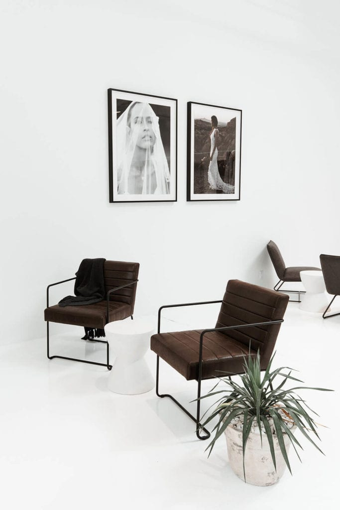 Light viewing space with several dark brown single chairs in our bridal showroom in New York