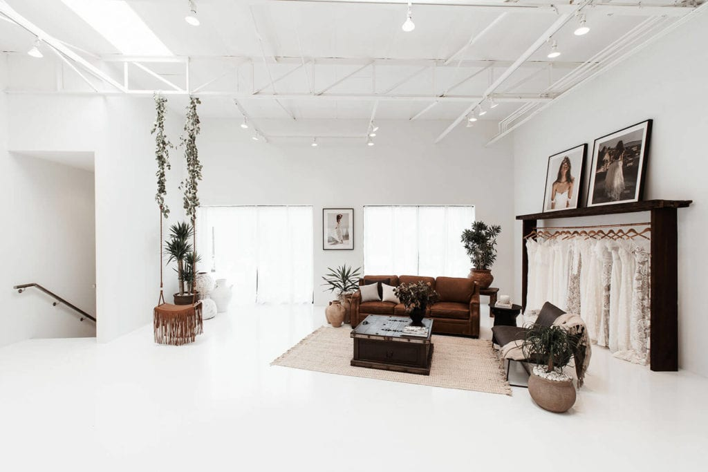 Large open space in our New York bridal gown showroom with lounge area and floor rug