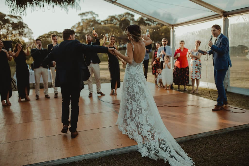 Bride wearing Grace Loves Lace Rosa Gown dancing with groom