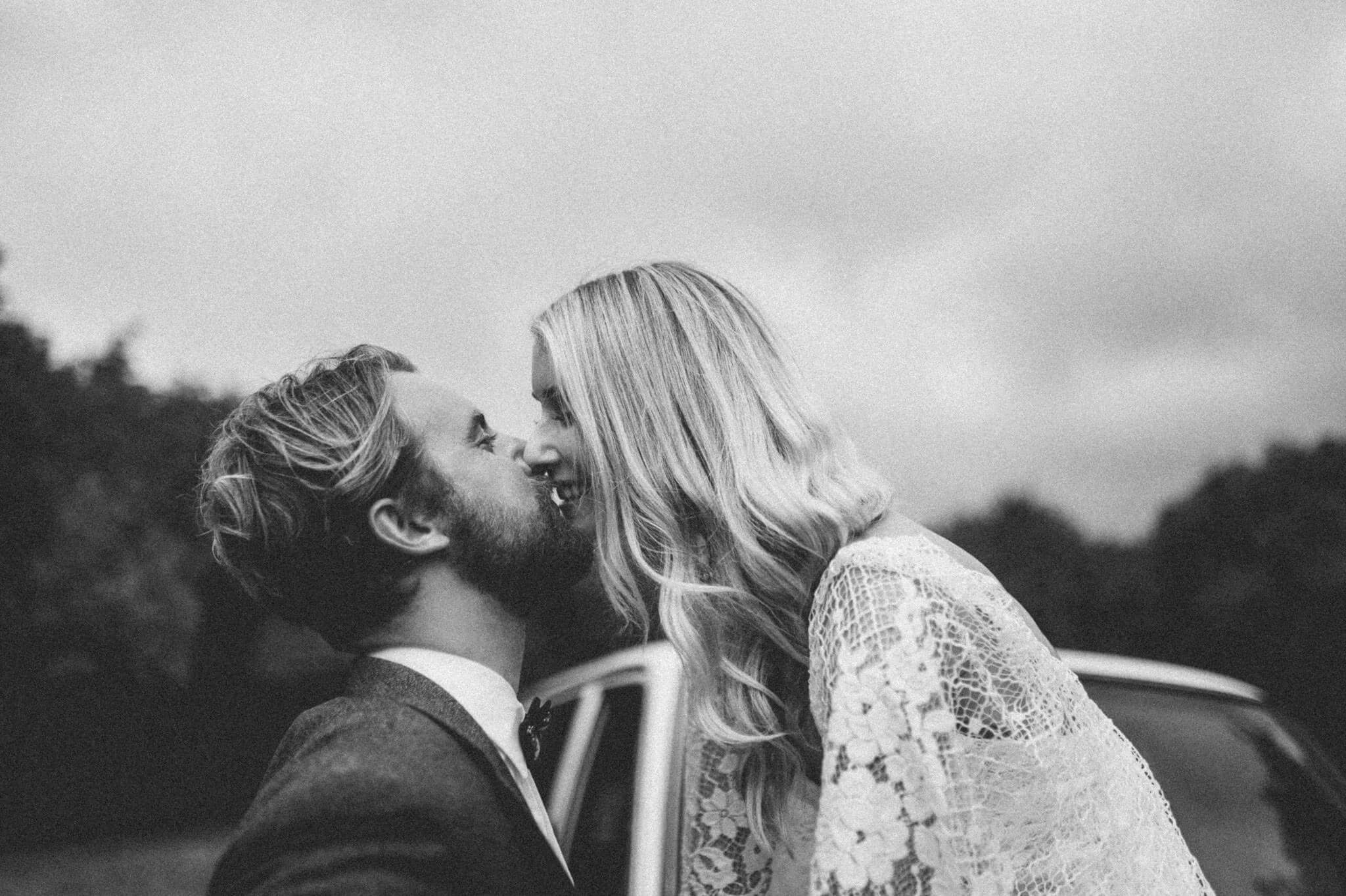 Bride wearing Grace Loves Lace Verdelle 2.0 Gown kissing groom