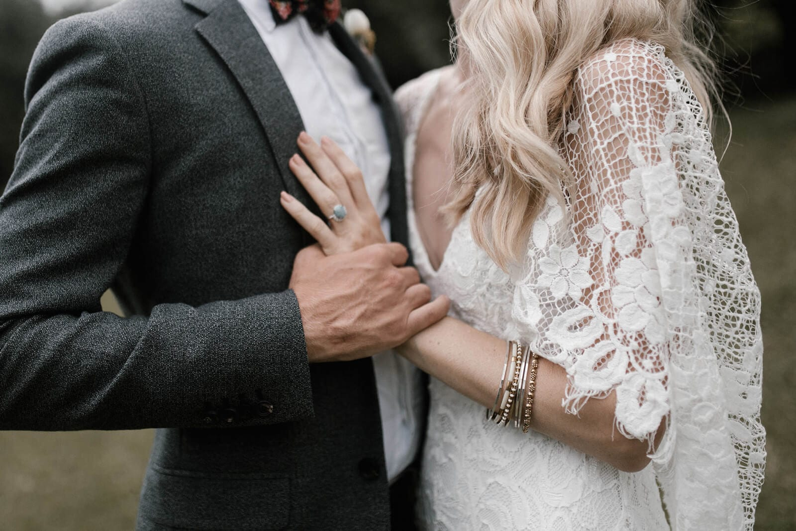 Close-up shot of bride wearing Grace Loves Lace Verdelle 2.0 Gown kissing groom