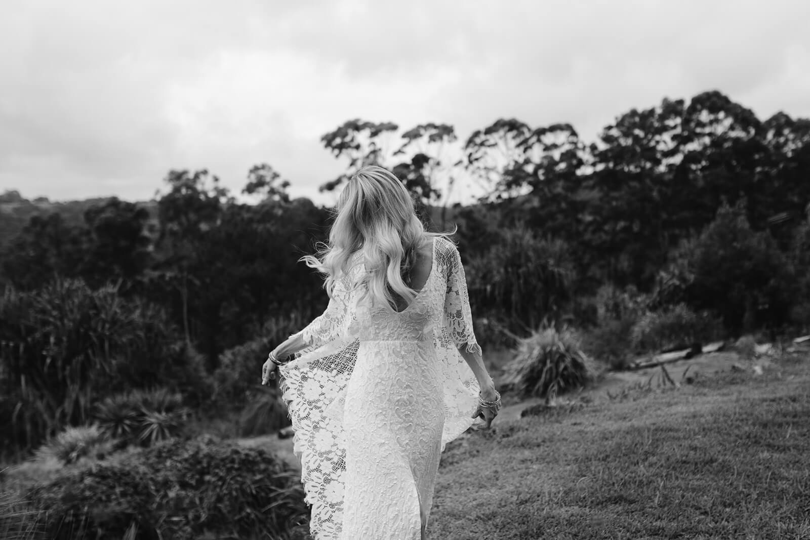Black and white shot of bride wearing Grace Loves Lace Verdelle 2.0 Gown