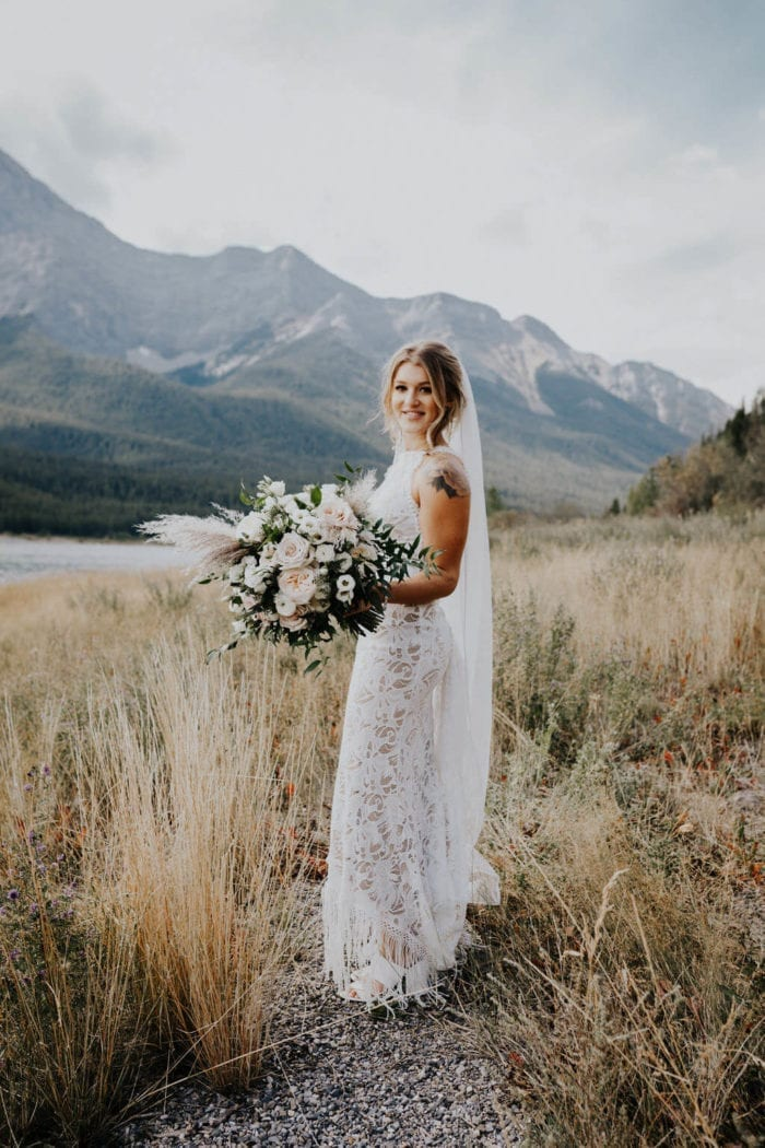 Blonde bride wearing Grace Loves Lace Edie Gown holding bouquet