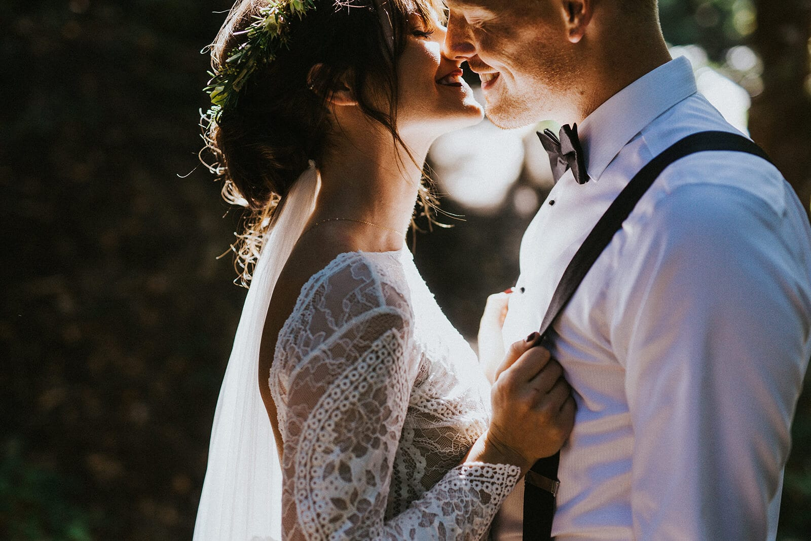 Bride wearing Grace Loves Lace Inca Gown leaning in to kiss groom