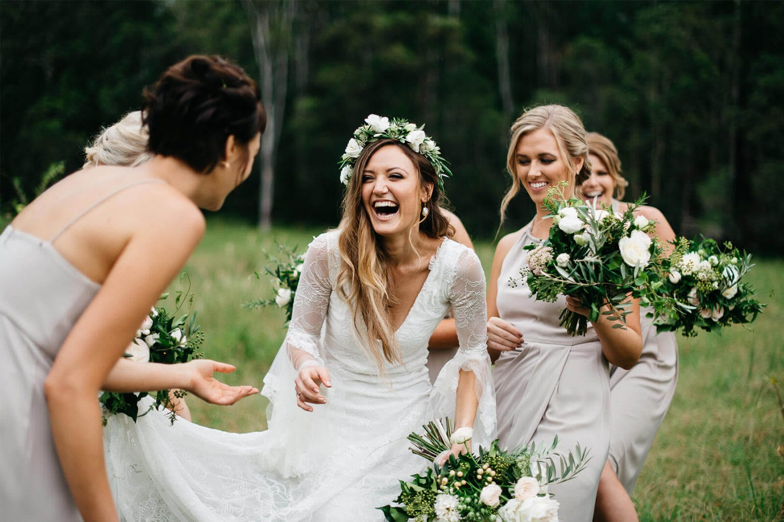 Blonde bride wearing Grace Loves Lace Francis Gown with bridesmaids holding bouquets