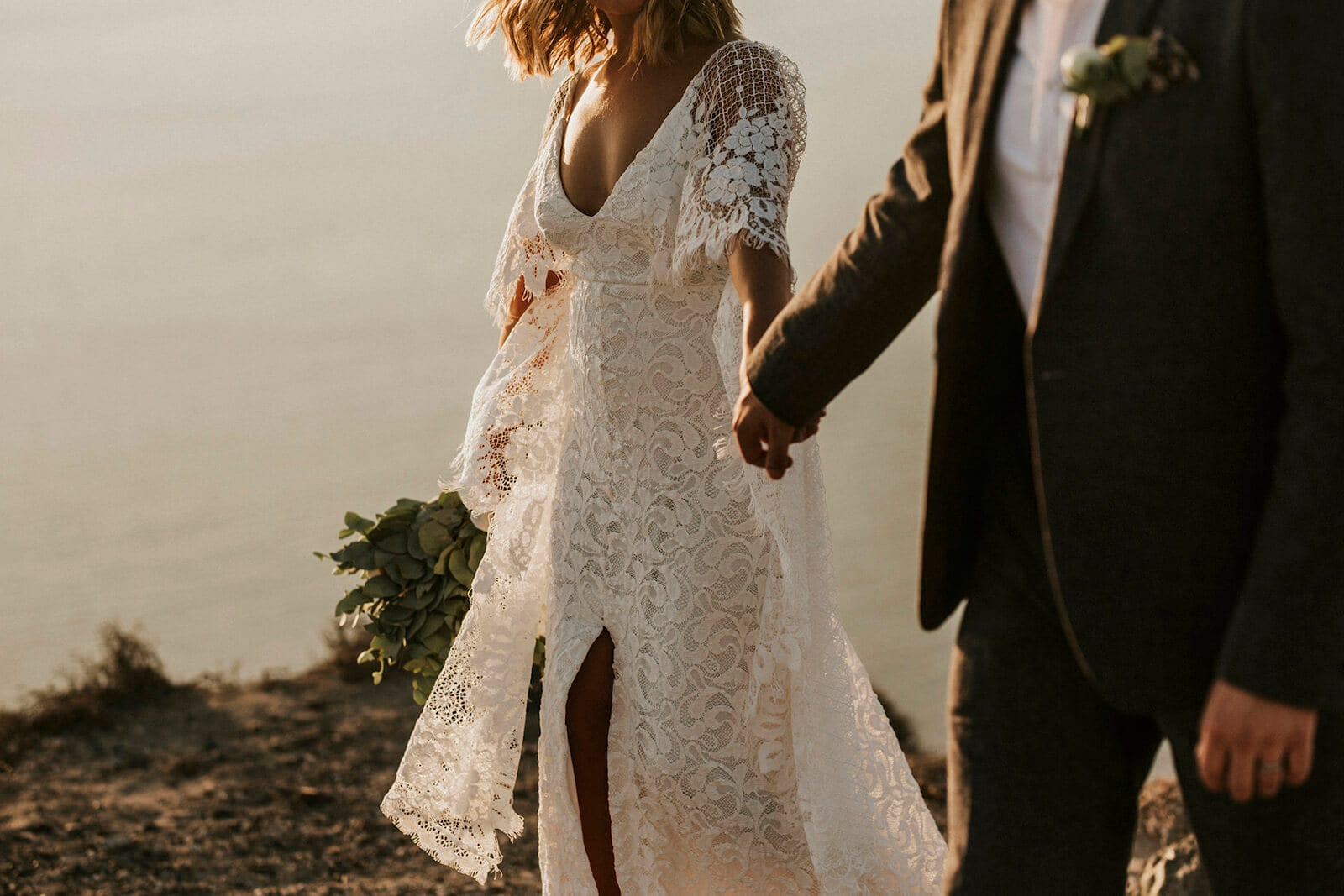 Bride wearing Grace Loves Lace Verdelle 2.0 Gown holding hands with groomVerdelle 2.0