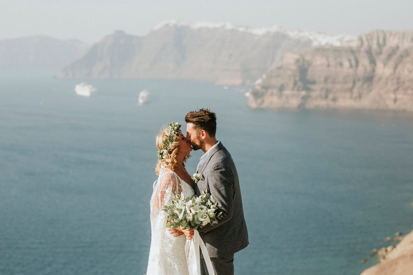 Bride wearing Grace Loves Lace Verdelle 2.0 Gown kissing groom
