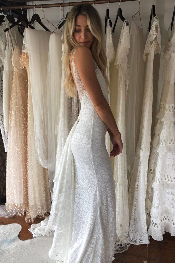 Blonde bride wearing Grace Loves Lace Gia Gown looking over shoulder