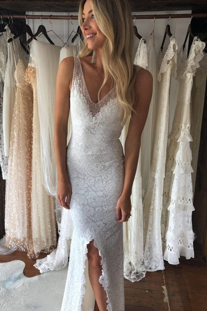 Blonde bride wearing Grace Loves Lace Gia Gown looking to the side