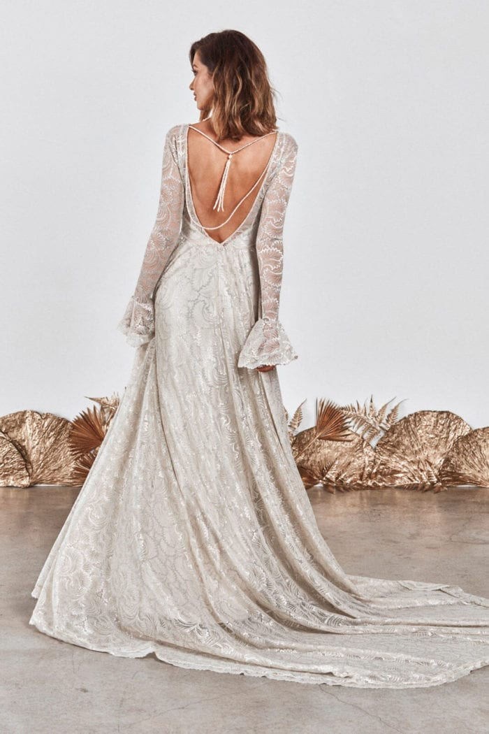 Back shot of bride wearing Grace Loves Lace Mata Backpiece looking to the side