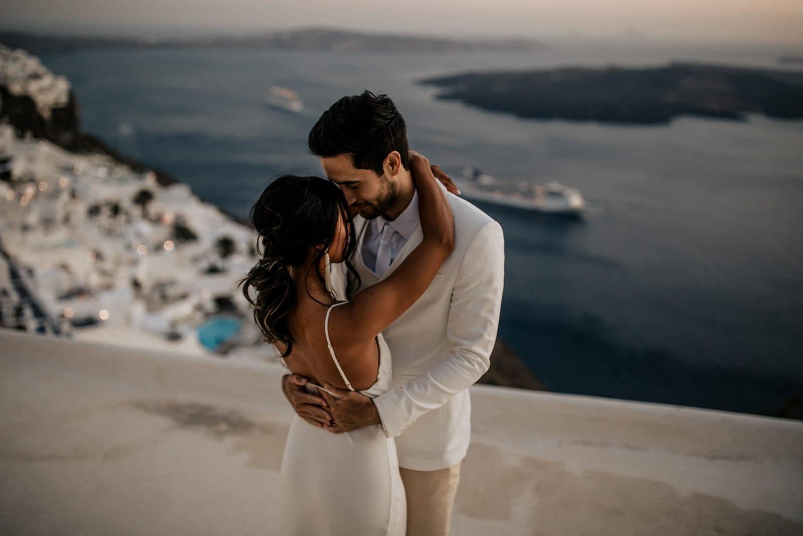 Brunette bride wearing Grace Loves Lace Arlo Gown embracing groom
