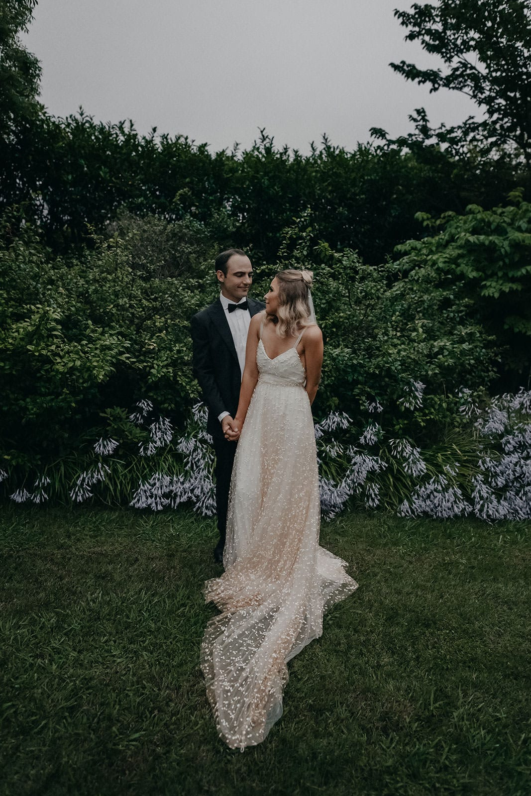 Blonde bride wearing Grace Loves Lace Menha Gown kissing groom