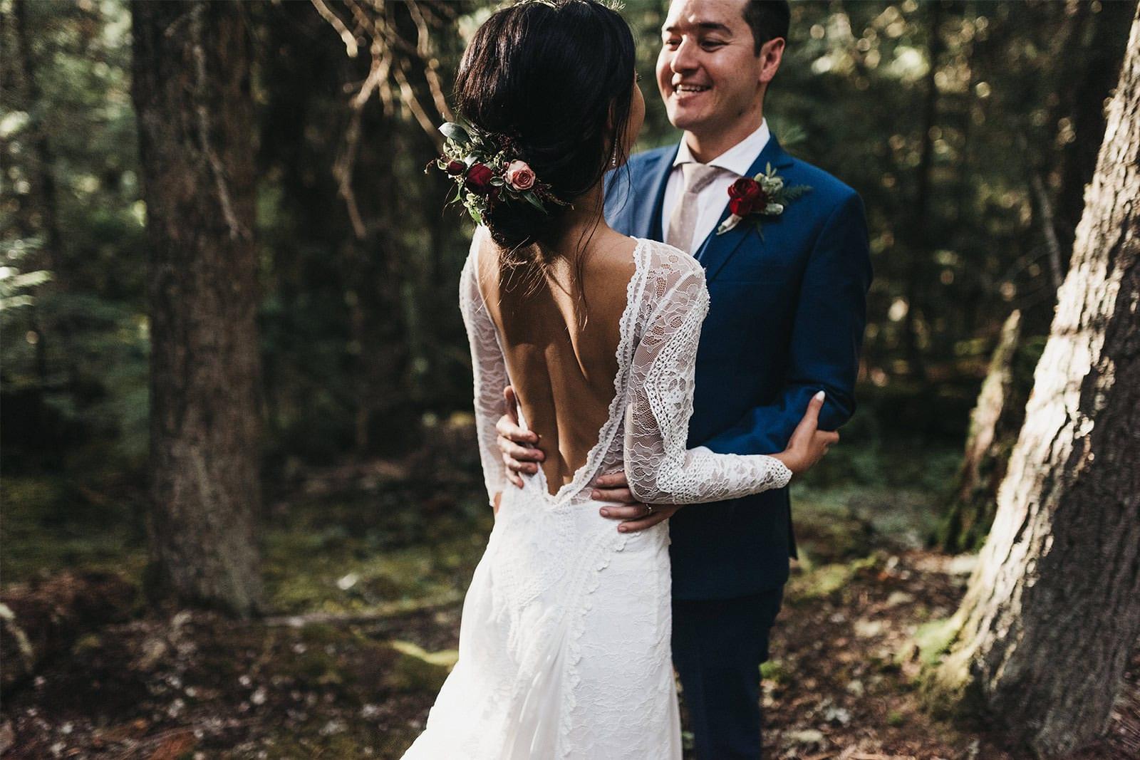 Bride wearing Grace Loves Lace Inca Gown being held by groom