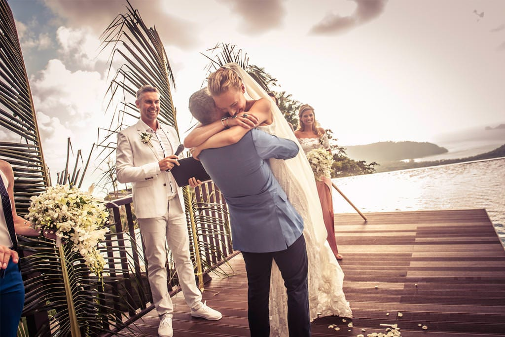 Blonde bride wearing Grace Loves Lace Lottie Gown embracing groom
