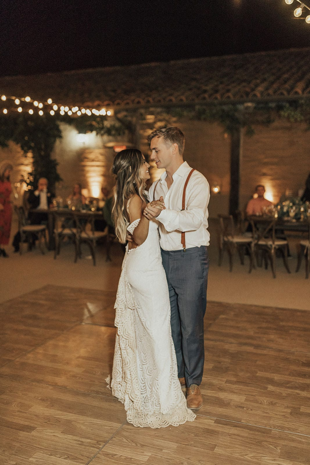 Blonde bride wearing Grace Loves Lace Paloma Gown dancing with groom