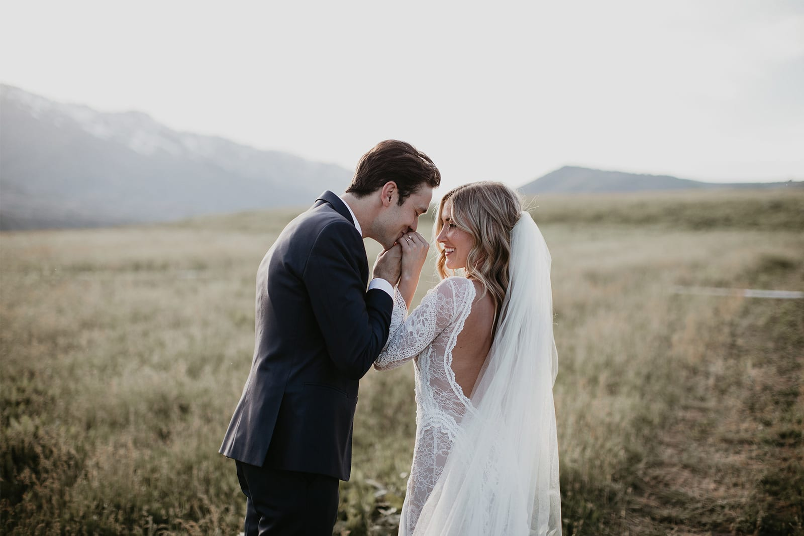 Bride wearing Grace Loves Lace Inca Gown being kissed by groom