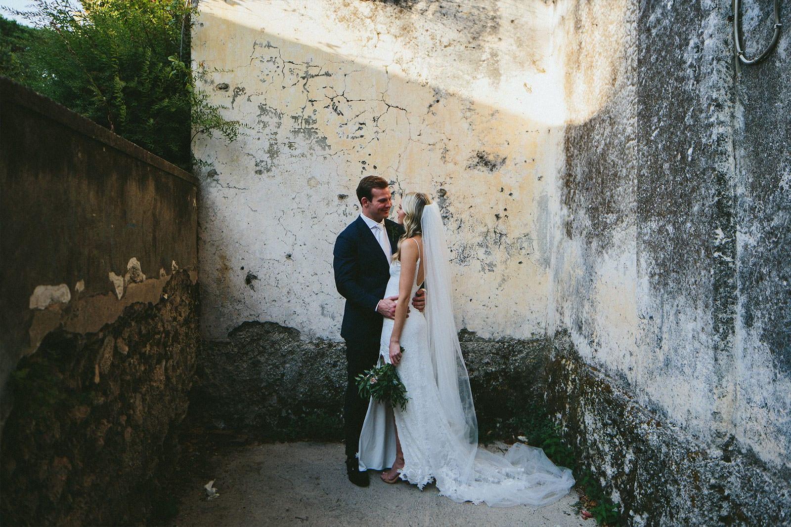 Blonde bride wearing Grace Loves Lace Lottie Gown being held by groom