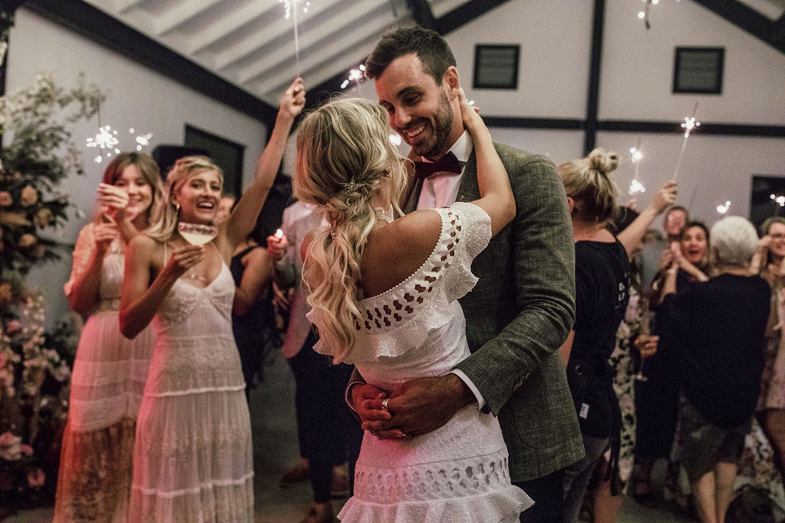 Blonde bride wearing Grace Loves Lace Coco Gown dancing with groom