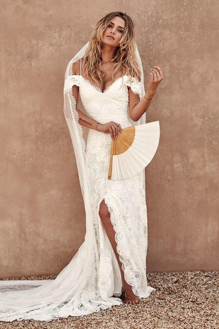 Bride wearing Grace Loves Lace Chantilly Veil holding a fan