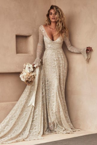 Blonde bride wearing Grace Loves Lace Bea Gown holding bouquet