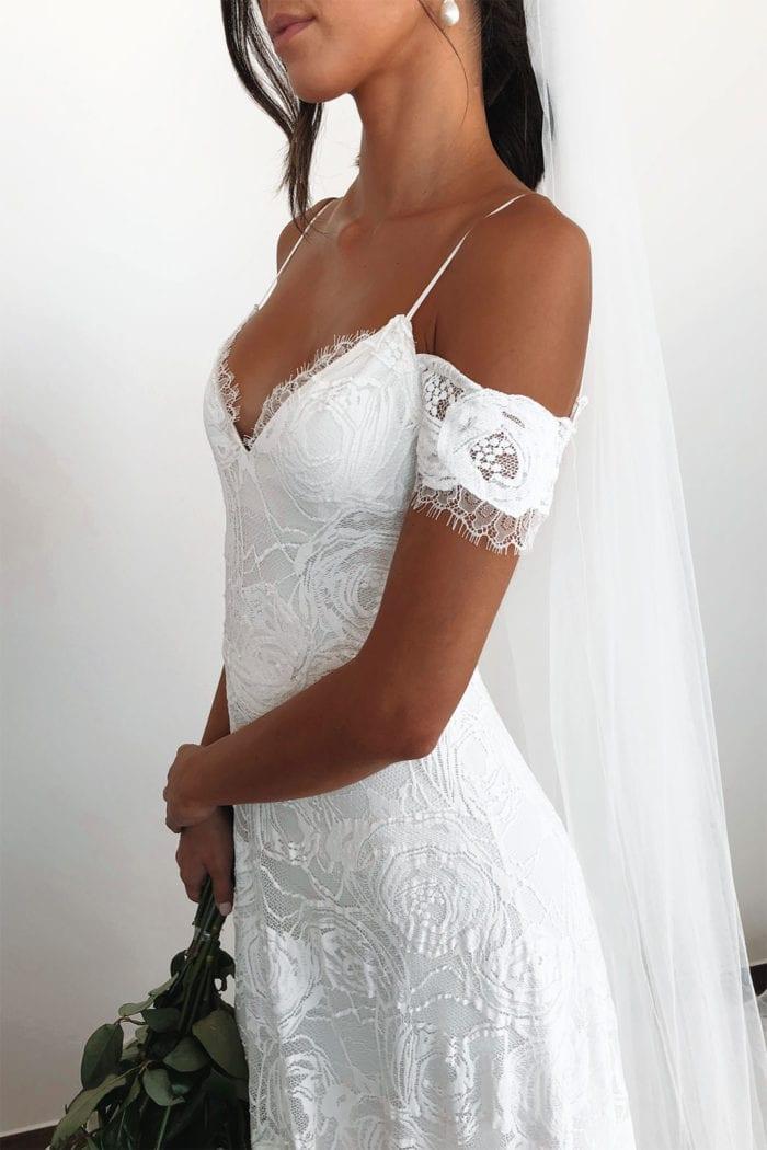 Bride wearing Grace Loves Lace Bonita Gown holding bouquet