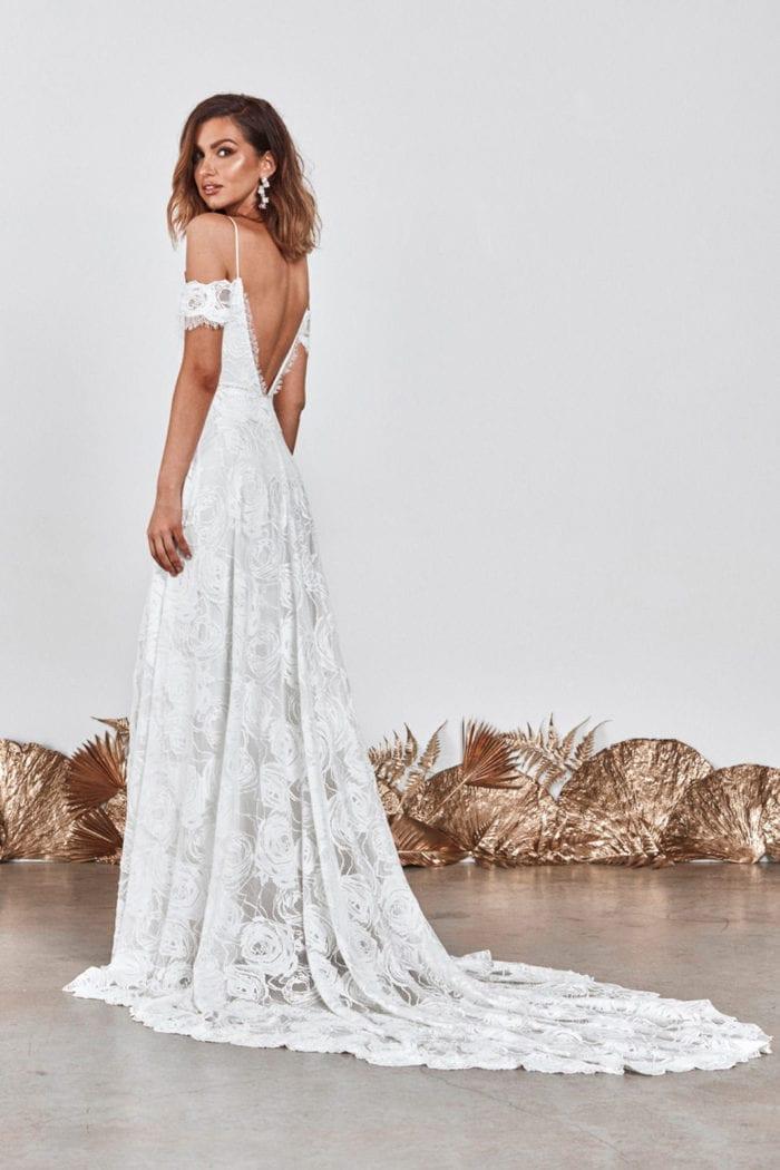 Back shot of bride wearing Grace Loves Lace Bonita Gown looking over shoulder