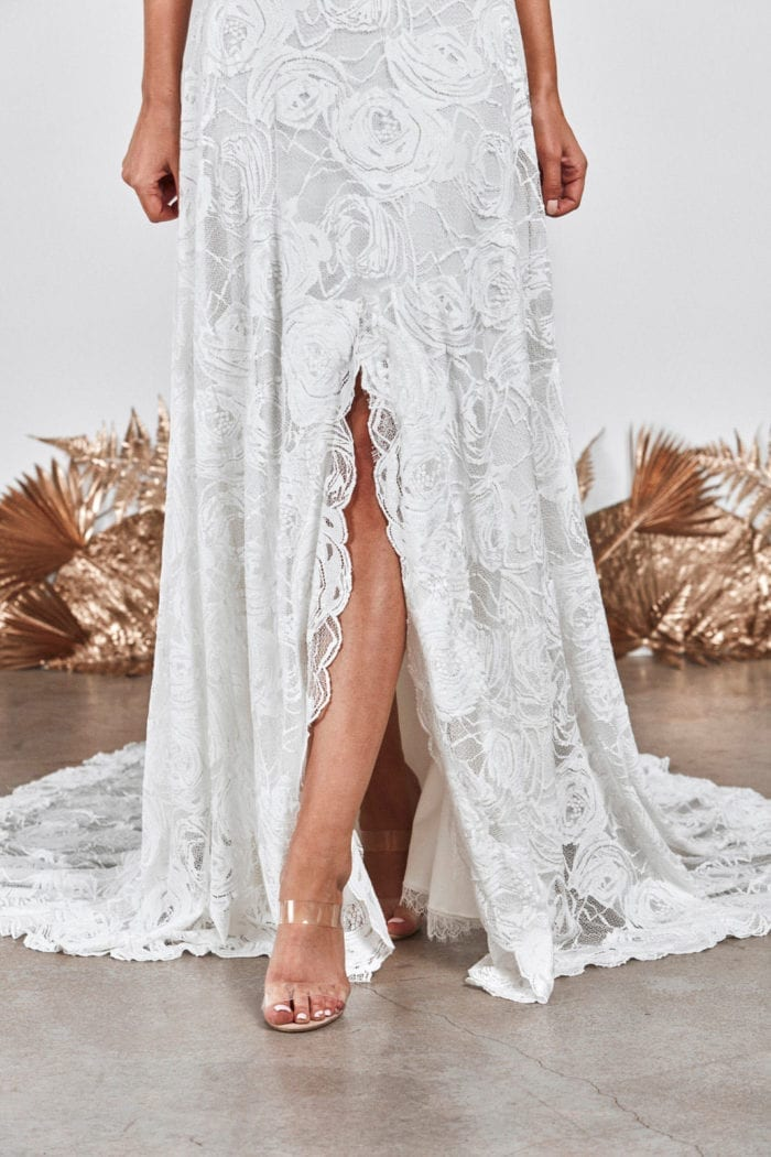 Close-up shot of Grace Loves Lace Bonita Gown showing skirt split with leg poking out