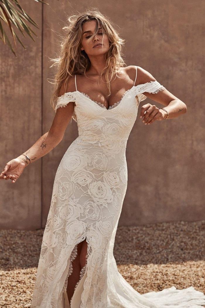 Bride wearing Grace Loves Lace Bonita Gown dancing