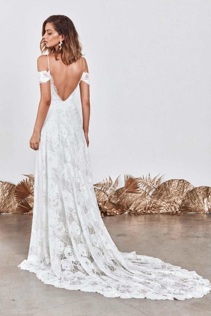 Back shot of bride wearing Grace Loves Lace Bonita Gown