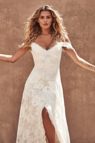 Bride wearing Grace Loves Lace Bonita Gown with arms outstretched
