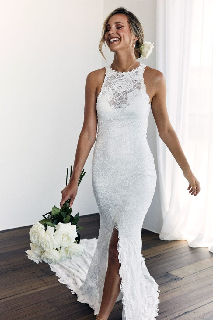 Bride wearing Grace Loves Lace Alexandra Rose Gown holding bouquet