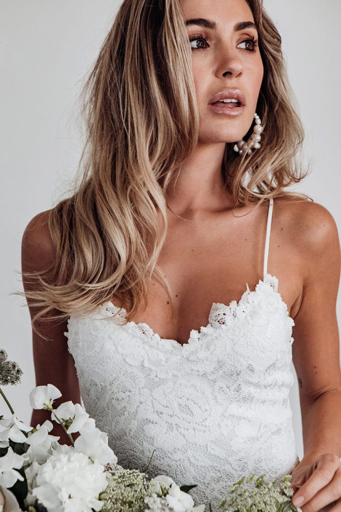 Bride wearing Grace Loves Lace Hart Gown holding bouquet
