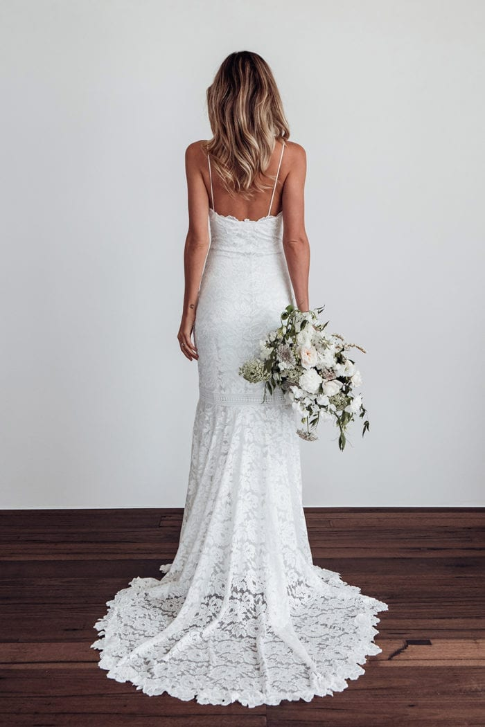 Back shot of bride wearing Grace Loves Lace Hart Gown holding bouquet